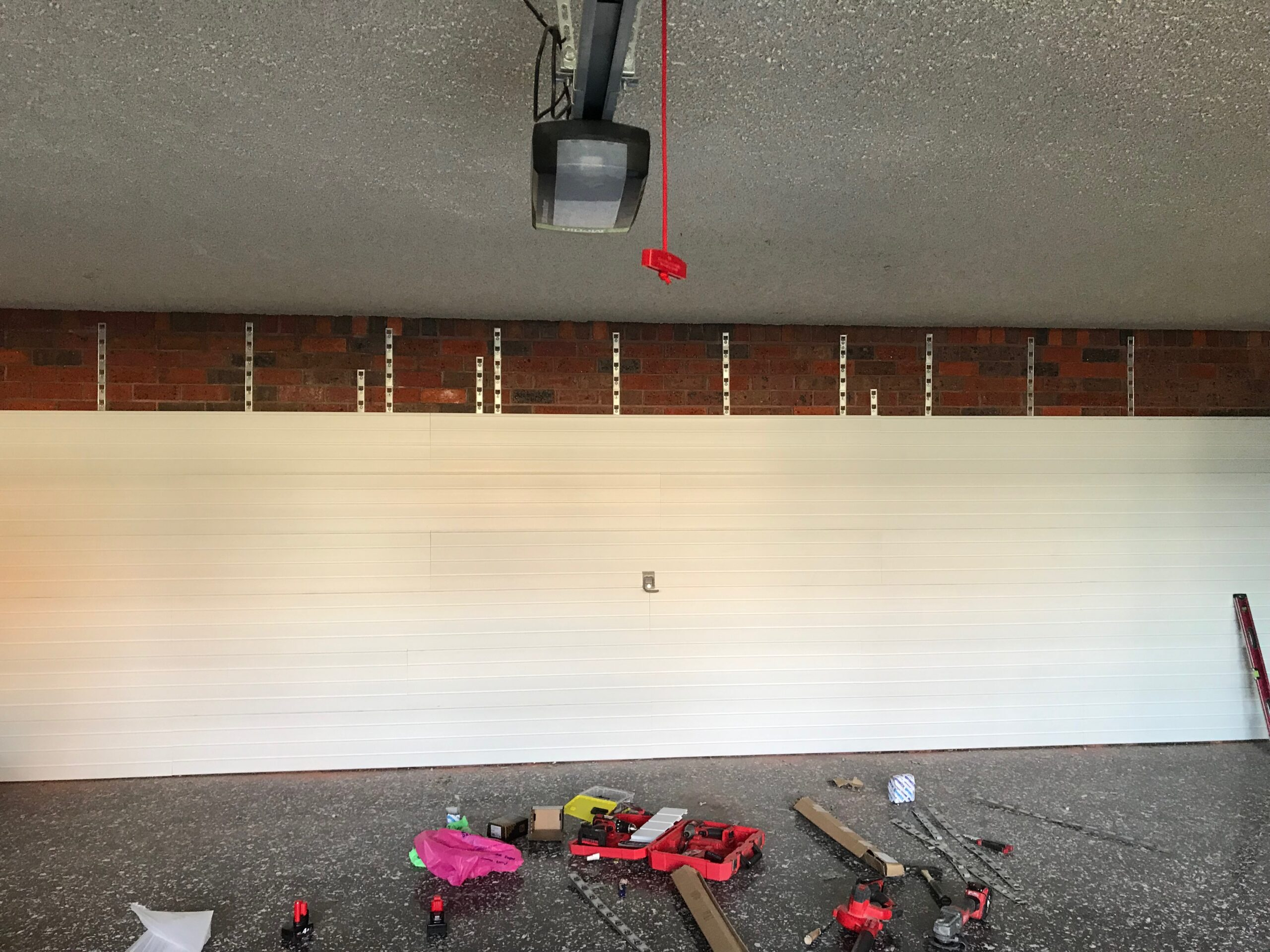 StoreWALL Brite White Panels on Brick Wall