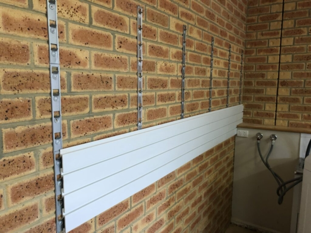 Installstrips on a Brick Wall