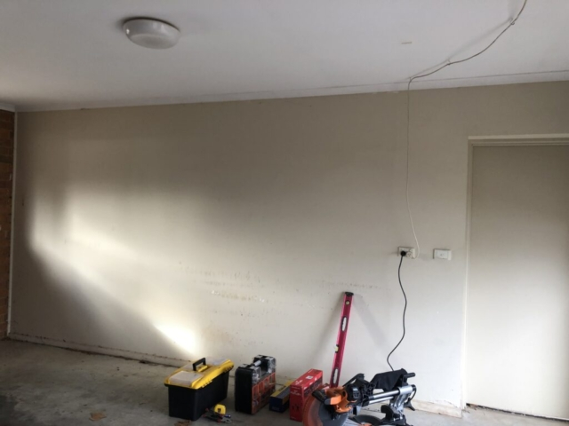 Shelves on a Plaster Wall