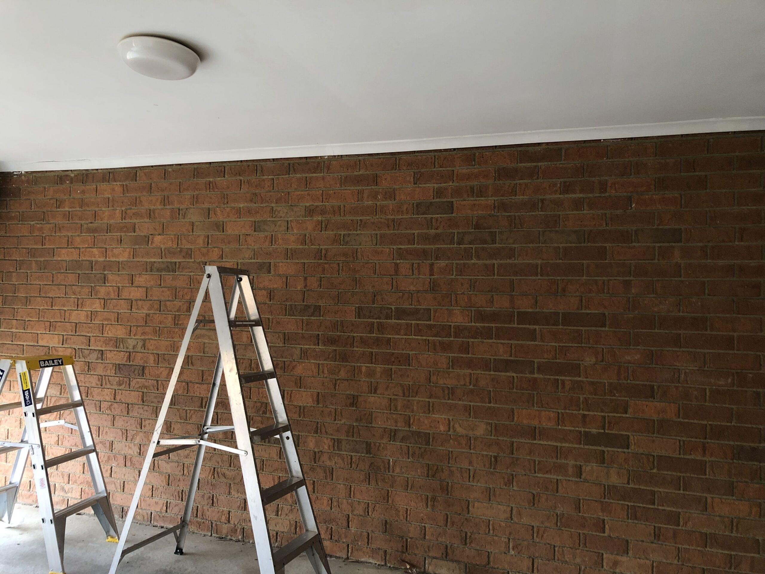 Shelves on a Brick Wall