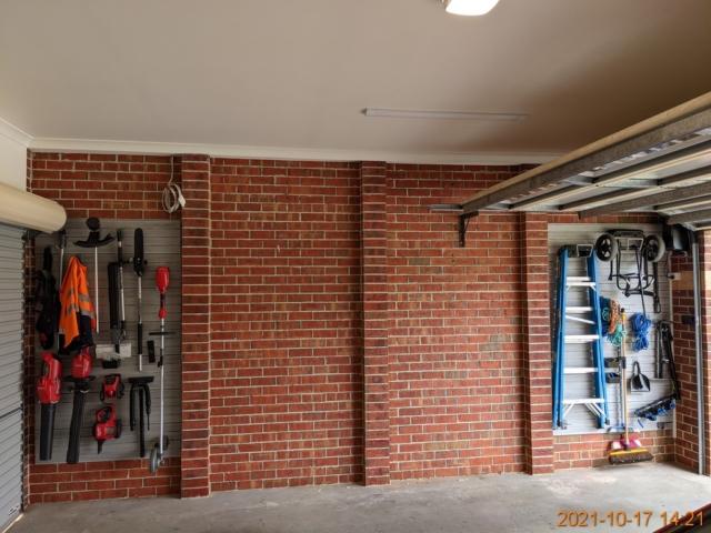 Barnwood Grey Wall Panels on a Brick Wall
