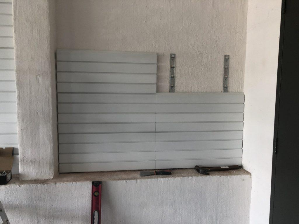 Storewall installation on brick wall